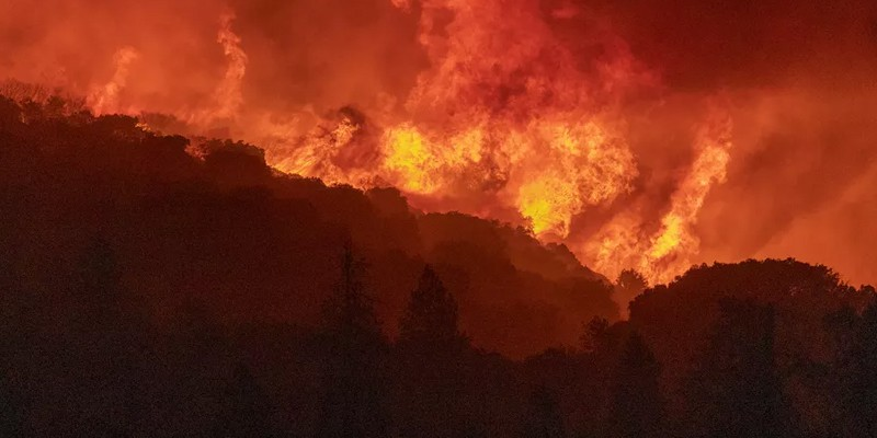 The wildfires in California have burned 2.2 million acres of land; 14,000 workers are working continuously to extinguish the fire